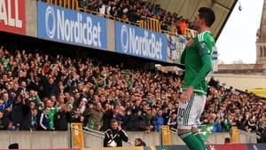 Kyle Lafferty celebrates in front of the home support as Northern Ireland beat Finland at Windsor Park