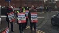 Dunnes workers strike in low-hour contract row