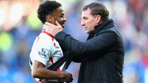 Raheem Sterling (L) with Liverpool manager Brendan Rodgers
