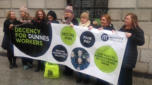Dunnes stores workers and former workers outside the GPO in Dublin