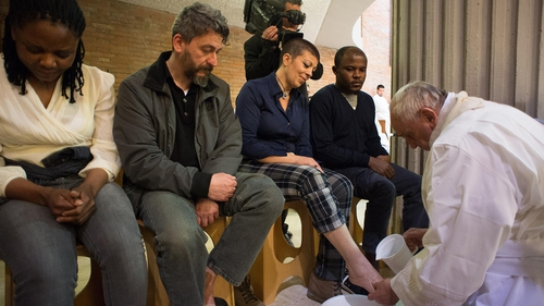Pope Francis washes a prisoner's feet during the traditional Washing of the feet at the Rebibbia jail in Rome