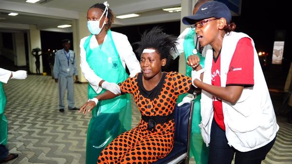 Paramedics attend to an injured Kenyan student as she is wheeled into Kenyatta National Hospital in Nairobi