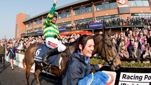 Barry Geraghty celebrates winning the Irish Grand National on Shutthefrontdoor last year
