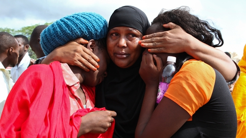 some of the Garissa University students who were rescued, comfort each other after the attack