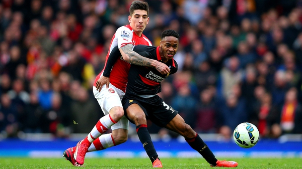 Raheem Sterling of Liverpool battles for the ball with Hector Bellerin of Arsenal