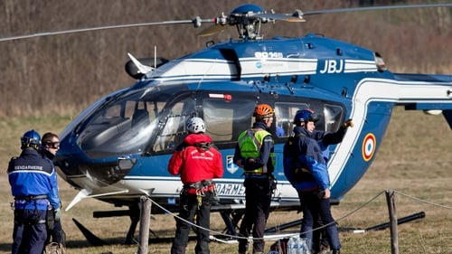 Alpine climbers take off in a police helicopter in Seyne Les Alpes, to search for the crash victims on 24 March