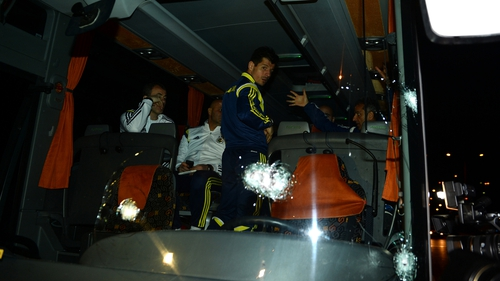 Football player Emre Belozoglu (C) and head coach Ismail Kartal (R)  inside the bus following the attack