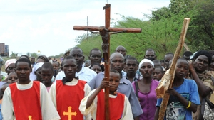 Catholic Church faithfuls take part in a proccession to re-enact the crucifixion of Jesus Christ in Machakos