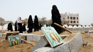 Women visit the graves of Houthi supporters in Sana'a  - over 500 people have been killed in Yemen in recent weeks