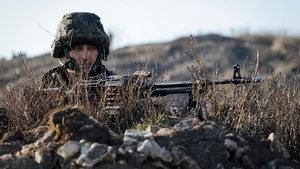 A Ukrainian soldier takes position at the front line near the town Kurahovo, not far from Donetsk
