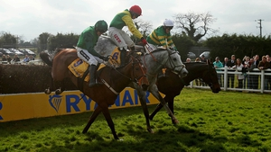 Tony McCoy on Gilgamboa (R) made winning move with huge leap at last fence