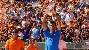 Novak Djokovic of Serbia holds aloft the Butch Bucholz trophy