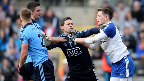 Dublin's Stephen Cluxton separates Jonny Cooper and Conor McManus of Monaghan