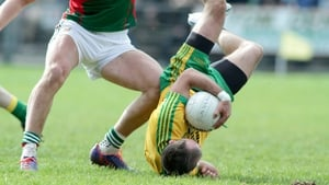 Donegal's Karl Lacey takes a tumble against Mayo