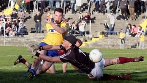 Roscommon's Diarmuid Murtagh scores a goal despite Galway goalkeeper Tadhg O'Malley's efforts