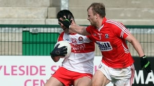 Derry's Eoin Bradley and Cork's Michael Shields in battle
