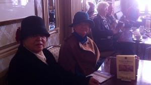 Women in traditional dress enjoy a coffee at Wynn's Hotel