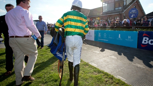 Tony McCoy leaving the parade ring as a jockey for the last time in Ireland