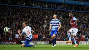 Christian Benteke scores the second of his three goals at Villa Park