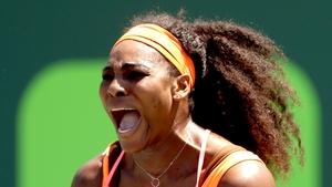 Serena Williams celebrates a point against Svetlana Kuznetsova of Russia during day 8 of the Miami Open