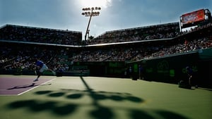 Novak Djokovic of Serbia returns the ball against Steve Darcis of Belgium during day 8 of the Miami Open at Crandon Park Tennis Centre