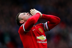 Wayne Rooney of Manchester United celebrates after scoring his team's second goal during the Barclays Premier League match between Manchester United and Aston Villa at Old Trafford
