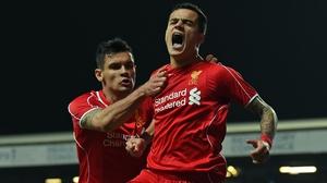 Liverpool's Brazilian midfielder Philippe Coutinho celebrates his 70th-minute strike at Ewood Park