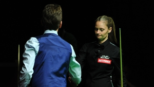 Ken Doherty commiserates with Reanne Evans after their match