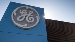 General Electric said its total quarterly revenue rose to $30.1 billion from $29.1 billion.
