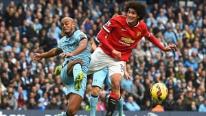Vincent Kompany and Marouane Fellaini in action at Old Trafford in 2015