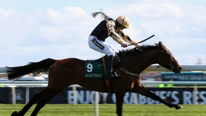 Ruby Walsh pushes Nichols Canyon out to win the opener on Grand National day
