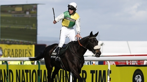 Leighton Aspell had enough in hand to keep Many Clouds up to his task in the Aintree spectacular