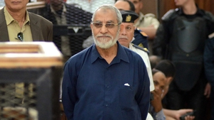 Mohamed Badie is pictured standing trial in Cairo last year