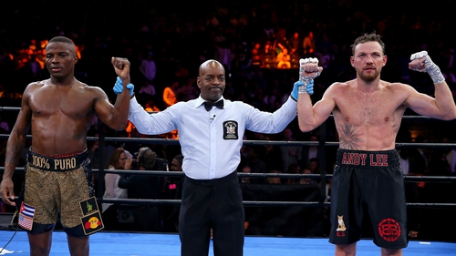 Peter Quillin and Andy Lee stand with the referee as it is declared a draw