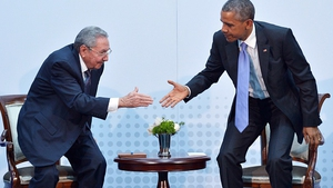 President Obama and President Raul Castro shake hands during a meeting in Panama