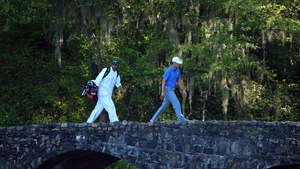 Jordan Spieth and his caddie walk over the Nelson Bridge on the 13th hole at Augusta