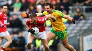 Cork's Eoin Cadogan under pressure from Michael Murphy of Donegal