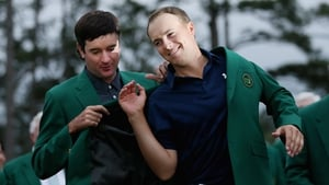 Bubba Watson adorns Jordan Spieth with the famous Green Jacket after the youngster won the 79th Masters by four shots