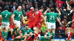 Wayne Barnes gives a penalty against Ireland