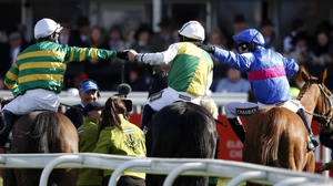 Leighton Aspell (C) is congratulated by Tony McCoy (L) and Paul Moloney (R) after winning the Grand National on Many Clouds at Aintree racecourse, Liverpool