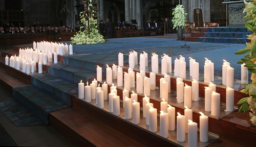During the service 150 candles were lit to mark each of the lives lost
