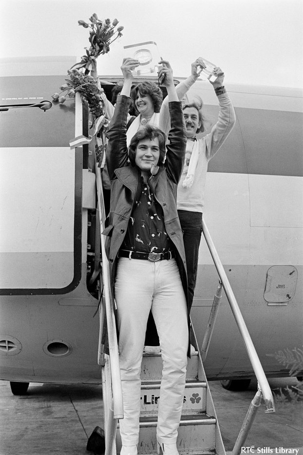Johnny Logan and Shay Healy on steps of airplane