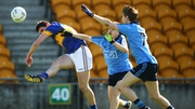 Tipperary's Colin O'Riordan under pressure from Eoin Murchan and Ross McGowan of Dublin