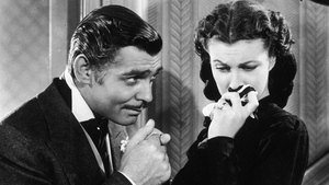 Rhett Butler (Gable) kisses the hand of a tearful Scarlett O'Hara in Gone with the Wind