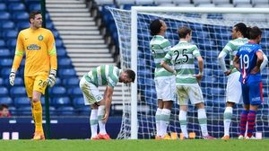 Celtic goalkeeper leaves the pitch after being sent off in the second half