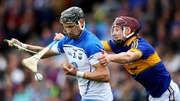 Tipperary's Paddy Stapleton tackle's Maurice Shanahan of Waterford