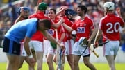Cork players celebrate after pipping the Dubs for a place in the league decider