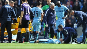 David Silva receives medical attention before being stretchered off to hospital