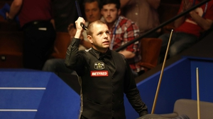 A relieved Barry Hawkins celebrates his nervy win over Matthew Selt