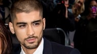Stephen Hawking reckons Zayn could still be part of One Direction in another Universe.